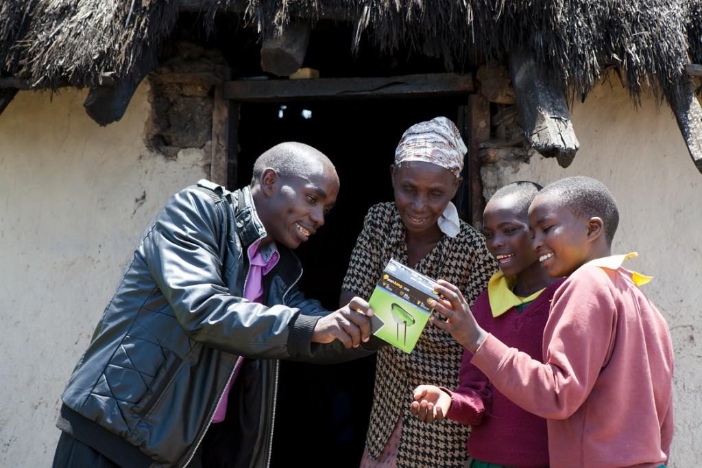 Gideon Langat delivering solar lights to rural house, Bomet county, Kenya